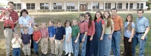 JimBob & Michelle Duggar, plus a whole lotta kids whose names begin with J.